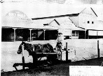 Pat Reilly in a horse-drawn cart at northern end Currie Street, Nambour, ca 1920
