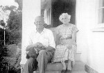 Christian William Ostenfeld with his wife Lillian on the steps of the Blue House, Noosa Heads, December 1957