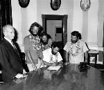 La Balsa crew signing the visitors book in the Maroochy Shire Council Chambers, Nambour, 6 November 1970